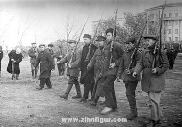 russian citizens with guns before stalin